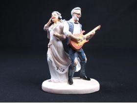 Figurine pour noces d'or - Couple casque et guitare